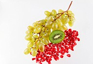 Grapes, grains of a pomegranate and kiwi