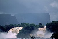 The Carrao River pours over two of its seven cascades at Hacha Falls below two tepuis, or flat sandstone mountains.