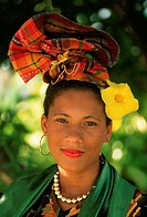 Annabelle Priera, a Creole woman, wears a traditional Guadeloupean headdress with a yellow flower. Basse_Terre, Guadeloupe.