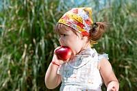 girl eats peach