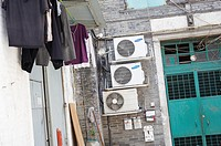 Clothes hung to dry and air conditioning units outside homes in Beco Da Felicidade  Macau  China