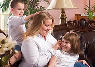 Mother and Children on The Couch