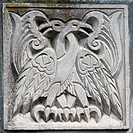 old bas_relief of fairytale two eagles