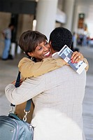 African_American Couple Hugging at Airport