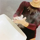 Gymnast Preparing Hands with Chalk