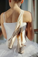 Ballet Dancer Holding Shoes over Shoulder
