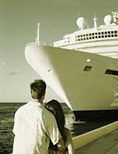 Couple Gazing Upward at Cruise Ship