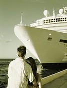 Couple Gazing Upward at Cruise Ship