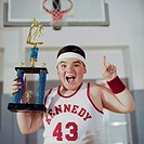 Happy Basketball Player Holding Trophy