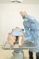 Physician Standing Over Dead Body in Morgue
