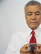 Asian Man Using Cell Phone