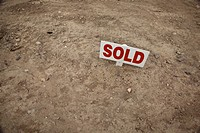 Sold Sign in Dirt Ground