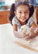 Girl Playing with Bread Dough