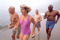 Elderly Friends Running on the Beach
