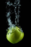 Golden apple splashing.