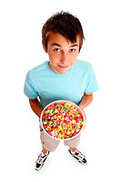 A boy holding a large bowl of coloured popcorn. White background.