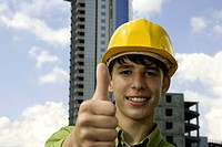 young worker with hard_hat on construction background focus on eyes