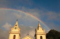 Church of Nossa Senhora das Neves and rainbow on sky after rainshower at Prazeres, Municipality of Calheta, Madeira, Portugal, Europe.