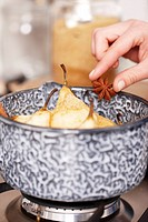 Adding star anise to peeled pears