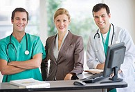 Portrait of doctors and businesswoman at nurse´s station