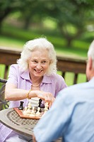 Seniors playing chess on porch