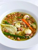 Winter vegetable soup with beans, turnips and Parmesan