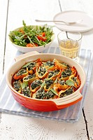 Conchiglie pasta shells with spinach filling and tomato sacue