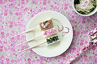 Tofu kebabs with sesame, radishes and chives