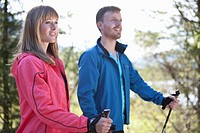 Germany, Upper Bavaria, Couple having nordic walk