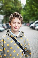 Germany, Berlin, Boy standing in street