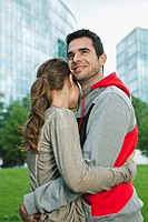 Germany, Berlin, Couple embracing in park