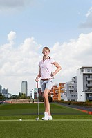 Germany, Bavaria, Munich, Young woman playing city_golf