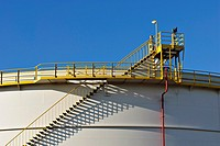 Detail of industrial storage tank with metal stairway