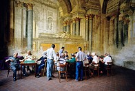 Sorrento  Italy  Men playing cards against a backdrop of fading frescoes in the Sedile Dominova