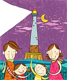 Portrait of happy family in front of lighthouse