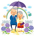 portrait of elderly couple in one umbrella