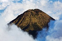 Landscape with Agua volcano surrounded by clouds