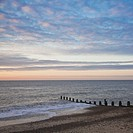 Groyne and dawn sky