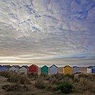 Line of beach huts in dunes