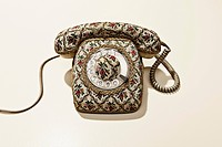 Old_fashioned telephone with floral pattern