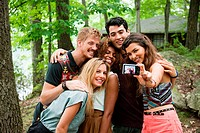 Friends posing in front of digital camera
