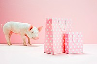 Piglet looking at pink spotted shopping bags
