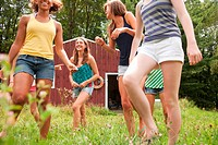 Teenage girls walking and having fun together in countryside