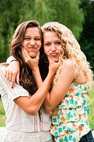 Two teenage girls fooling around and making faces (thumbnail)