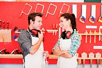 Carpenters in front of wood work tools (thumbnail)