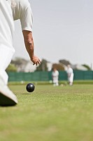 Older man lawn bowling