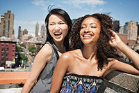 Portrait of two young women in urban setting