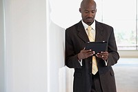 Portrait of businessman using digital tablet
