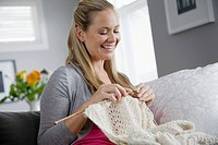 Woman knitting at home