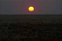 Sun setting over rural landscape